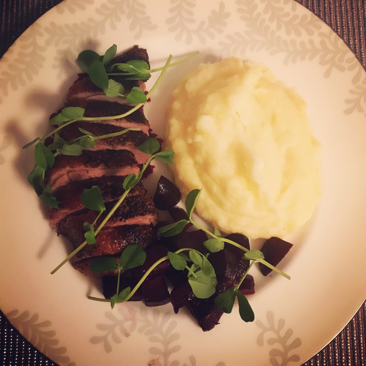 Pan seared, oven roasted duck breast with garlic potato mash and roasted beetroot