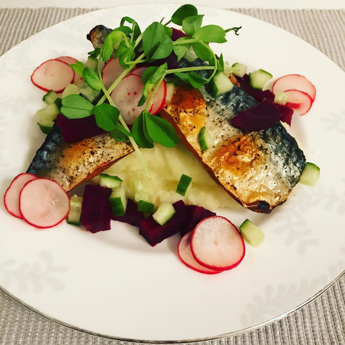 Grilled mackerel with wasabi potato mash, cooked beetroot and pickled cucumber and radish